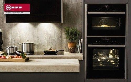 NEFF kitchen appliances in a stone wall kitchen