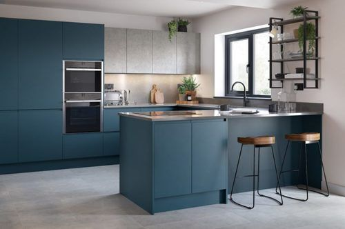 Image of a modern blue and grey kitchen design with concrete worktops and cupboards.