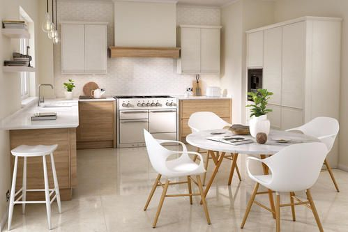 Image of a white and cream multifunctional kitchen design, featuring wooden kitchen units and marble countertops and surfaces