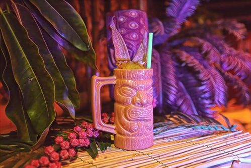 tiki mug cocktail with fresh fruit cocktail