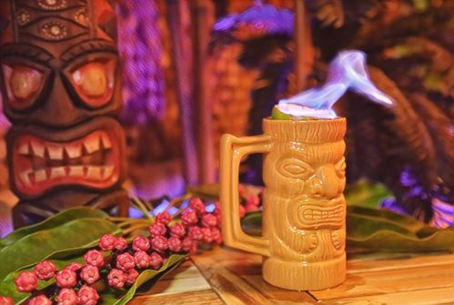 zombie cocktail with flaming lime in tiki mug