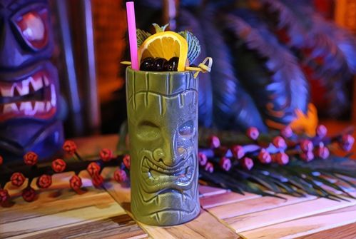 green tiki mug with fresh fruit garnish