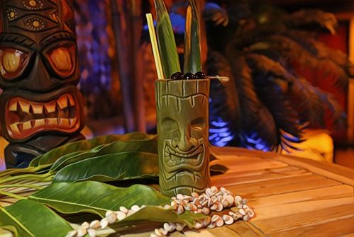 green tiki mug with cherries and pineapple leaves as granish
