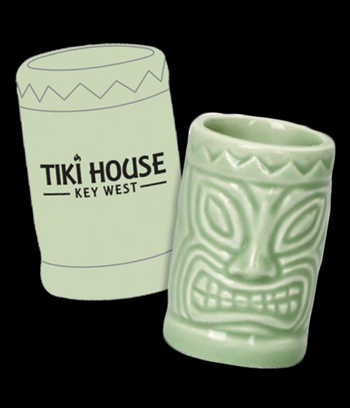 pale green ceramic tiki style shot glass with tiki logo on back