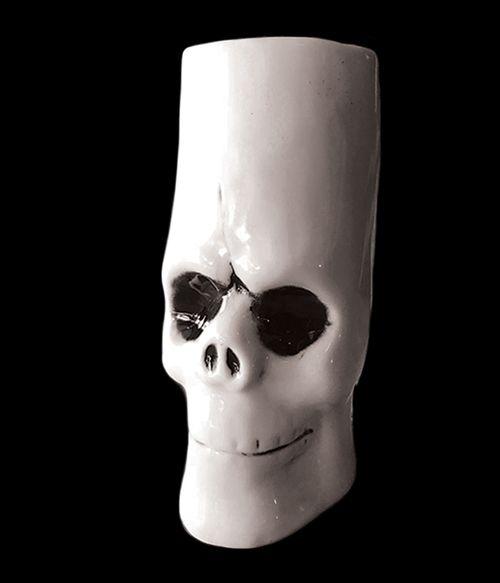 white ceramic skull tiki mug