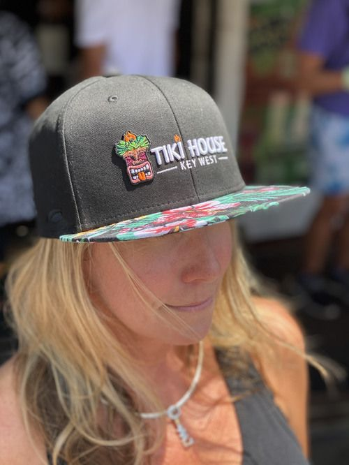 brimmed caps with pineapple pattern in black with tiki house key west logo embroidered.