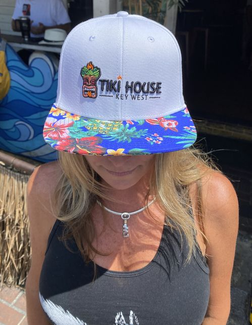 brimmed caps with pineapple pattern in black and white with tiki house key west logo embroidered.