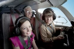people in airplane cockpit