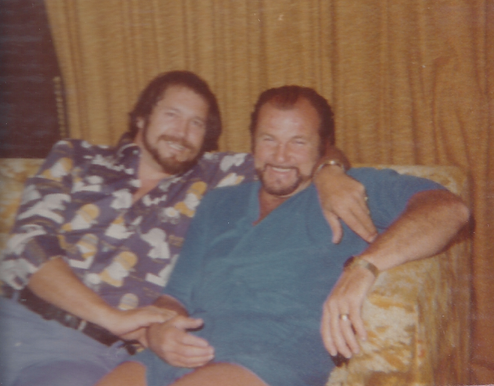 Luke and Dutch smiling on a couch