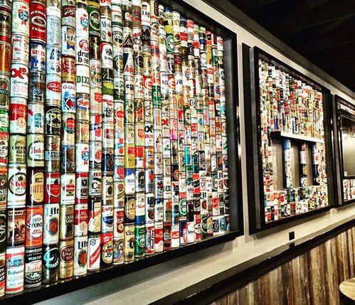 Image of David Sloan's legendary beer collection on display at Mary Ellen's