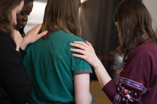 Girls Praying Together.
