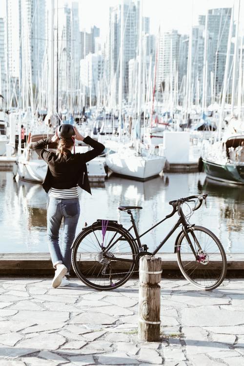 Girl Riding Bike On Vancouver Seawall.