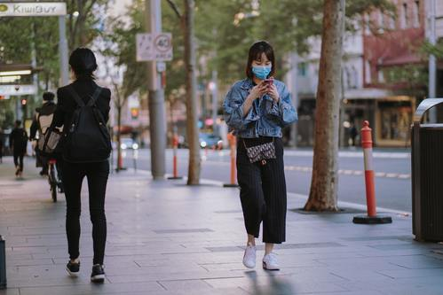 Girl In Downtown Vancouver Wearing COVID-19 Face Mask.