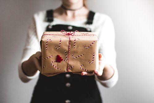 Girl Holding Christmas Gift.