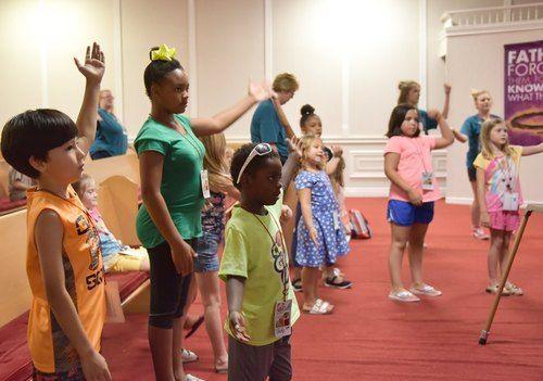 Smithfield Kids worshiping Jesus.