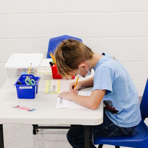 child doing school work