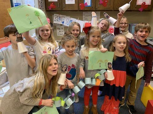 Children in Kids Worship holding a pumpkin craft project