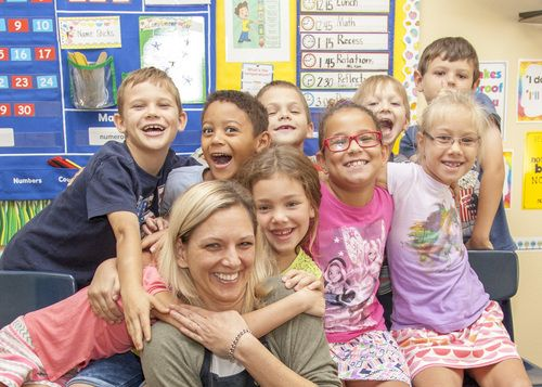 students of woodland early childhood center smiling