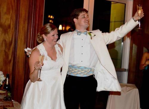 wedding bride and groom with custom cummerbund set for formal wedding