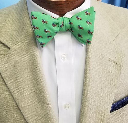 green bow tie with polo horses