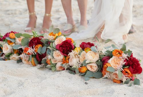 Bridal Bouquets on The Beach In front of Women's Feet