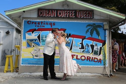 Bride and Groom Kissing in front of Cuban Coffee Queen Mural