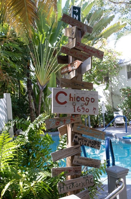 directional signage point to major cities located near the pool at The Banyan Resort