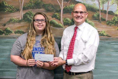 Michael Ford presenting Kaitlyn Harris with her scholarship check.